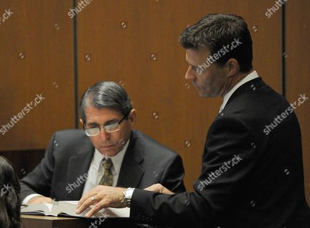 Dr. Paul White is questioned by Deputy District Attorney David Walgren