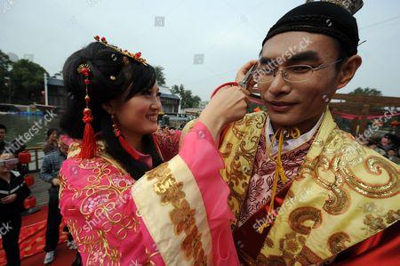 Groom Xu Xianbao and bride Zhou Wei during their Tang Dynasty style wedding