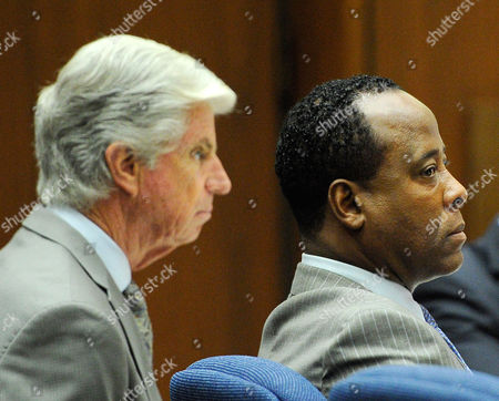 Defence attorney J. Michael Flanagan and Dr. Conrad Murray look on during the final stage of Conrad Murray's defence