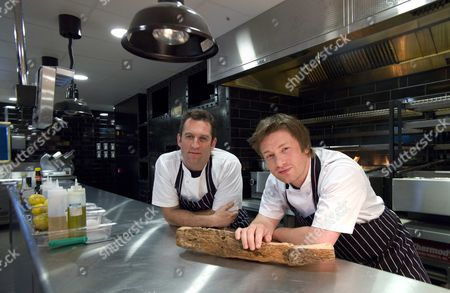 Editorial photo of Chefs Jamie Oliver And Adam Perry Lang At Their New Restaurant In Cheapside London: Jamie Oliver Today Urged Londoners To Unleash Their 'inner Caveman' As He Announced A A3 Million Shrine To Meat-eating In The Heart Of The City. His Latest Restaura