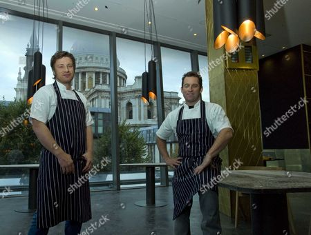 Chefs Jamie Oliver And Adam Perry Lang At Their New Restaurant In Cheapside.london: Jamie Oliver Today Urged Londoners To Unleash Their 'inner Caveman' As He Announced A A3 Million Shrine To Meat-eating In The Heart Of The City. His Latest Restaurant Barbecoa Which He Opens Next Week In Partnership With New York 'flame King' Adam Perry Lang Is His Most Ambitious Single Venture To Date.