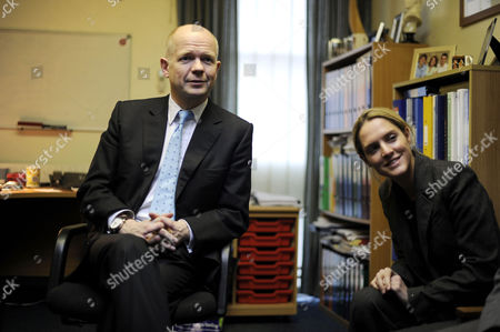 William Hague talks to politics students during a visit The Kingswood School in Corby with PPC Louise Mensch