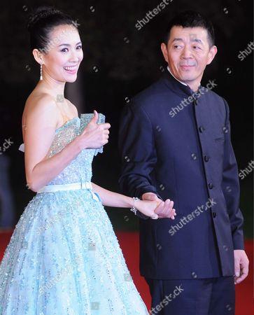 Stock Picture of Zhang Ziyi and Changwei Gu