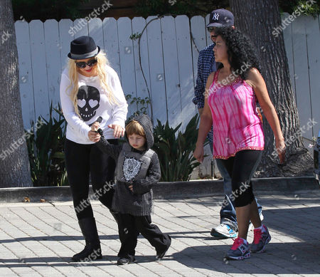 Christina Aguilera and son Max Bratman dressed as a knight with Jordan Bratman (behind)