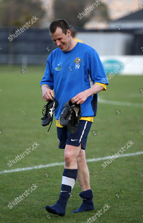 Steve Claridge of Gosport Borough FC smiles as he leaves the pitch