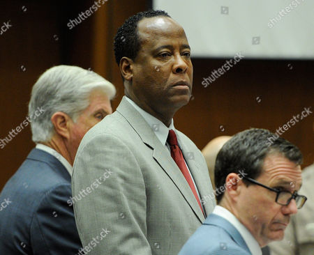 Dr. Conrad Murray and defence attorneys J. Michael Flanagan and Edward Chernoff