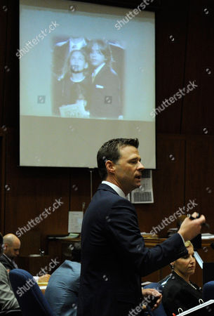 Deputy District Attorney David Walgren with a slide projection of Michael Jackson's children Paris and Prince