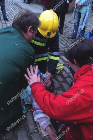 Stock Picture of Iain Rogerson (Harry Flagg) and Julie Hesmondhalgh (Hayley Cropper) tends to an unconscious Vicky Entwistle (Janice Battersby) after she is dragged from the factory.