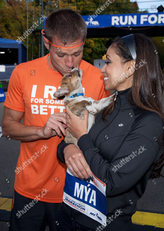 Stock Photo of Dr. Andrew Baldwin and Mya with puppy
