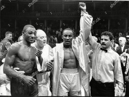 Boxing : Referee Enzo Montero Raises Mike Mccallum's Hand After Win. Herol Graham V Mike Mccallum World Middleweight Championship At Albert Hall