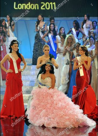 Miss Venezuela Ivian Lunasol Sarcos Colmenares wins the 2011 Miss World final at Earls Court London, with Gwendoline Ruais from the Philippines (left, red dress) and 3rd place Amanda Perez from Puerto Rico (right red dress), Sunday November 6, 2011.
