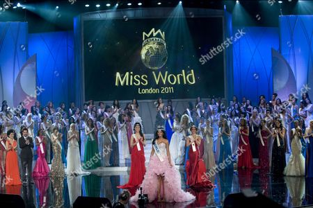 Stock Picture of Miss Venezuela Ivian Lunasol Sarcos Colmenares wins the 2011 Miss World final at Earls Court London, with Gwendoline Ruais from the Philippines (left, red dress) and 3rd place Amanda Perez from Puerto Rico (right red dress), Sunday November 6, 2011.
