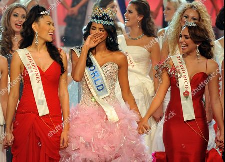 Stock Photo of Miss Venezuela Ivian Lunasol Sarcos Colmenares wins the 2011 Miss World final at Earls Court London, with Gwendoline Ruais from the Philippines (left, red dress) and 3rd place Amanda Perez from Puerto Rico (right red dress)