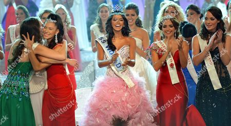 Stock Image of Miss Venezuela Ivian Lunasol Sarcos Colmenares wins the 2011 Miss World final at Earls Court London, with Gwendoline Ruais from the Philippines (left, red dress) and 3rd place Amanda Perez from Puerto Rico (right red dress), Sunday November 6, 2011.