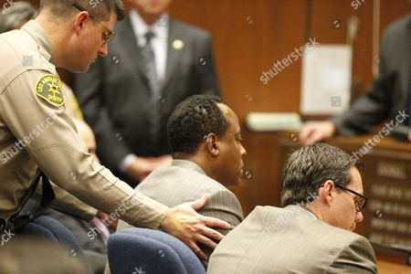 Defence attorney Edward Chernoff looks away as Dr. Conrad Murray is remanded into custody after the jury returned with a guilty verdict