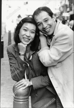 Actor David Yip And Actress Lucy Sheen Take A Break From Filming