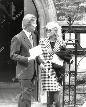 Michael York Actor With Unnamed Woman At Funeral Of Actor Roy Kinnear 1988.
