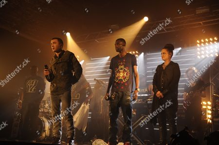 Jonny Clarke as Bart (L) rushes the stage while Wretch 32 performs