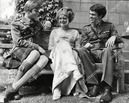 Melissa Fairbanks Daughter Of Douglas Fairbanks And Her Husband Richard Morant (left) With Michael York (right) In A Scene For The Film Zeppelin