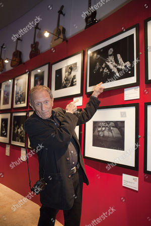Stock Picture of Baron Wolman in front of his picture of Jimi Hendrix at the 'Gibson Through The Lens' exhibition at the British Music Experience