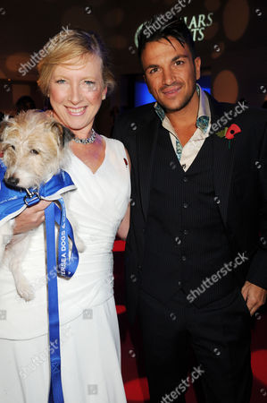Stock Image of Claire Horton (CEO of Battersea Dogs and Cats Home) with Peter Andre (host)