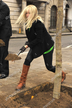Jo Wood planting a tree