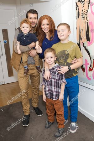Stock Picture of Natasha Hamilton with Alfie Erraji, (son) Riad Erraji (husband), and Harry Erraji, Josh Erraji Cosgrave