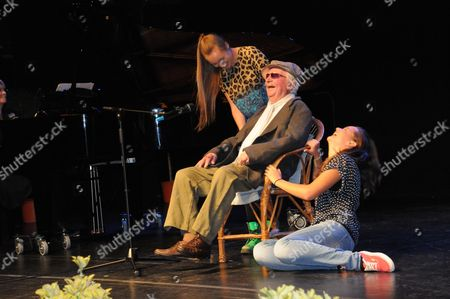 Stock Picture of Clive Dunn OBE now 91 years old, came briefly out of retirement to take to the stage again to perform his hit No1 single 'Granddad' with his own granddaughters, Lydia and Alice