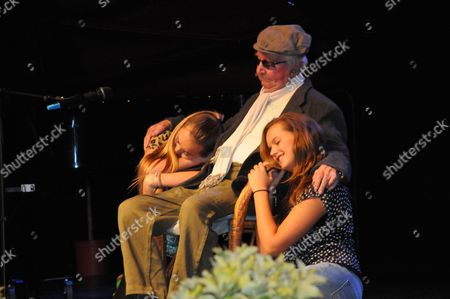 Stock Photo of Clive Dunn, 91 years old, came briefly out of retirement to take to the stage again to perform his hit No1 single 'Granddad' with his own granddaughters, Lydia and Alice