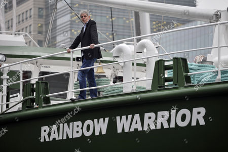 John Sauven, the Executive Director of Greenpeace aboard the environmental organisation's flagship, Rainbow Warrior, after making her maiden voyage from Amsterdam