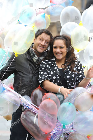 Matt Cardle and 18 year old Shereece Marcantonio a sex education campaigner with multicoloured condoms.