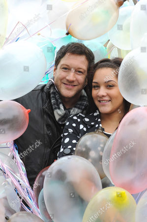 Matt Cardle and 18 year old Shereece Marcantonio a sex education campaigner with multi coloured condoms.