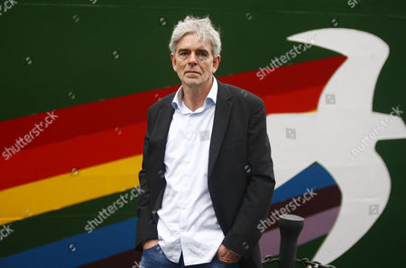 John Sauven with the Greenpeace flagship 'Rainbow Warrior III'