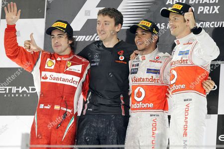 From left, second place Ferrari driver Fernando Alonso of Spain, Andy Latham Neil Wilkinson race engineer, McLaren Mercedes driver Lewis Hamilton of Britain, winner, and third placed McLaren Mercedes driver Jenson Button of Britain stand on the podium during at the Emirates Formula One Grand Prix.