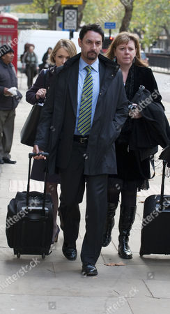 Jay Hunt Arrives For An Industrial Tribunal Hearing Pictured To The Left Hiding Behind Her Legal Team Holborn London.