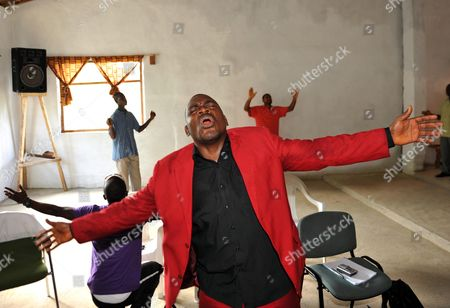 Stock Picture of Joshua Milton Blayhi Aka General Butt Naked One Of The Liberian Civil War's Most Notorious Warlords Turned Evangelist Preacher Delivers A Sermon To The Congregation Of A Church In Monrovia. See Story Edna Fernandes