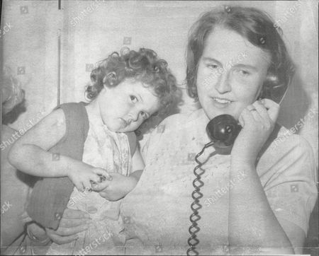 Stock Picture of Janet Wright And Daughter Tracy Wright Talk On Telephone To Janet's Husband Pc Charles Wright Who Wad Held Hostage By Escaped Gunman Barry Robinson 1974.