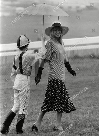 Model Janet Murray At Epsom Racecourse Where The Rain Kept Falling. Lucky She Had A Jockey To Keep Her Dry