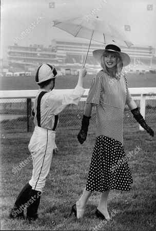 Stock Picture of Model Janet Murray At Epsom Racecourse Where The Rain Kept Falling. Lucky She Had A Jockey To Keep Her Dry