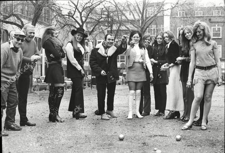 A New Game Called Petanque Being Played. Wrestler Mick Mcmanus And His Ex-wife (in Large Black Hat) Lena Moss To His Right