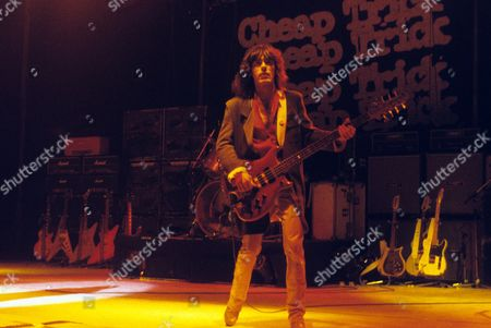 Stock Photo of Cheap Trick - Tom Petersen in concert at the Hammersmith Odeon, London