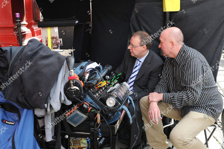 Paul Ferris watching film takes with director Ray Burdis