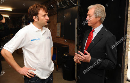 Chairman of Barclays Marcus Agius (R) with Bikeworks staff