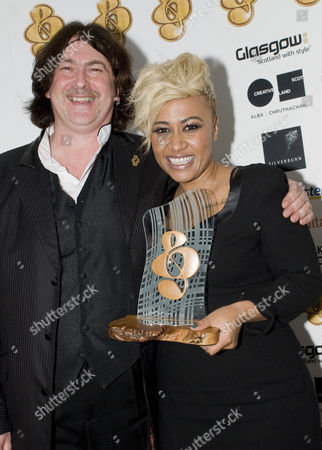 Fundraising Chairman Donald Macleod and singer and songwriter Emeli Sande receiving the 'Capital FM Best Breakthrough Artist Award' at The Tartan Clef Awards 2011'