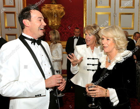 Stock Picture of Camilla Duchess of Cornwall and sister Annabel Elliott (centre) talk to Craig Revel Horwood