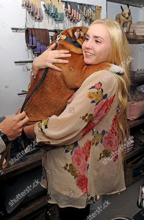 Stock Picture of Saffron Le Bon and dog