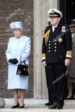 Queen Elizabeth II stands beside First Sea Lord, Admiral Sir Mark Stanhope