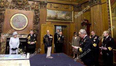 Queen Elizabeth II accompanied by First Sea Lord, Admiral Sir Mark Stanhope and her husband Prince Philip, listen to a speech on recent naval history
