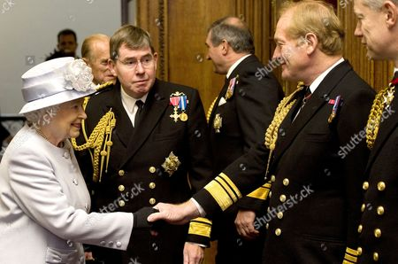 Queen Elizabeth II, accompanied by First Sea Lord Admiral Sir Mark Stanhope, meets military members of the Navy Board