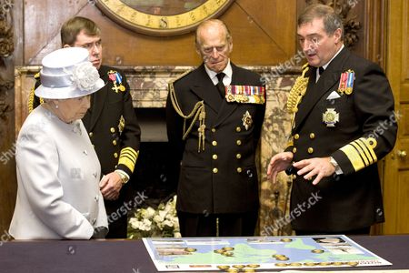 Queen Elizabeth II, accompanied by First Sea Lord, Admiral Sir Mark Stanhope and Prince Philip, Prince Philip, are shown a map detailing current naval deployments by Admiral Sir Trevor Soar